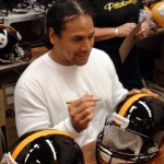 Polamalu signing black steelers helmet
